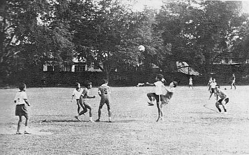 A friendly game between two great  primary school football rivals - St. John's Island School and St. Michael's School in the 1970s.
