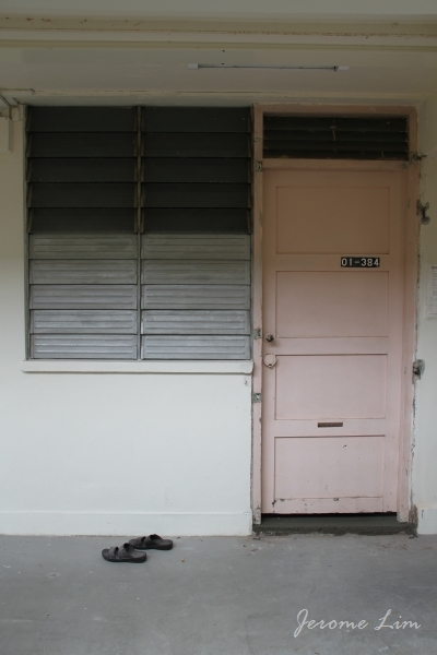 A flat that has retained the original door and window louvres which would have been used for more than 40 years. & Old HDB Door | The Long and Winding Road
