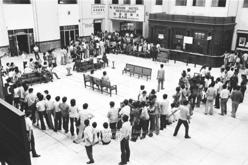 The festive crowd - when queues formed for tickets in the lead up to Chinese New Year. Many with roots in Malaysian would return by train to their home towns for the important holiday (photo source: National Archives online)