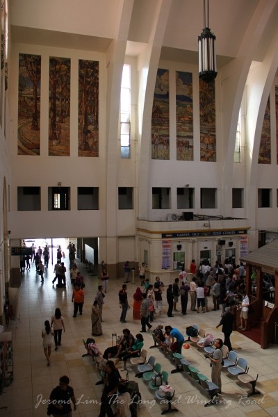 The main hall of the station. Part of the vaulted ceiling and batik-style mosaic panels can be seen.