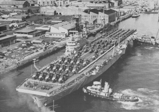 HMS Bulwark off the northwall of the Naval Base in the 1960s - the northwall is where the far end of the shipyard is today.