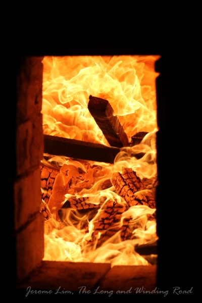 A look into the belly of the dragon - the firing box aglow during a firing of the kiln.