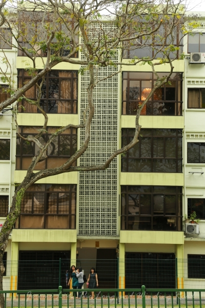 One of two private apartment blocks next to Novena Church.