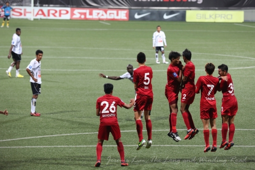 A LionsXII wall jumps in response to a Terengganu free-kick.