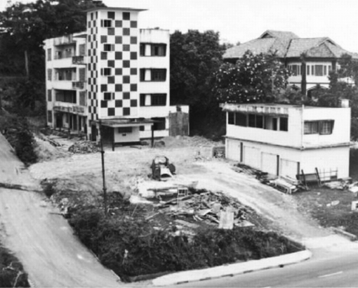 The four storey building, Adam Court, next to Dr. W. C. Cheng's clinic seen from Thomson Road before it was demolished in 1978. The two storey building in the foreground was a parking garage for Adam Court.