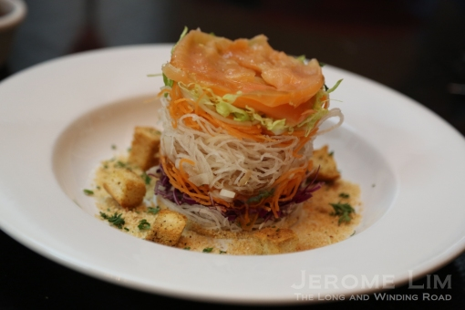 Yu Sheng that is served not with raw fish, but with smoked salmon and tossed with a fork.