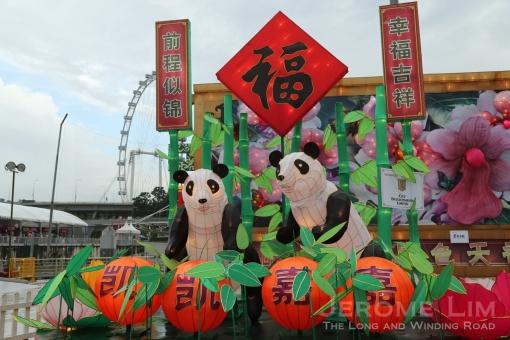 A lantern featuring giant pandas.