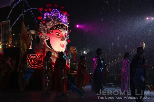 Participants rehearsing through the pouring rain - exemplifying the spirit of Chingay 2013.