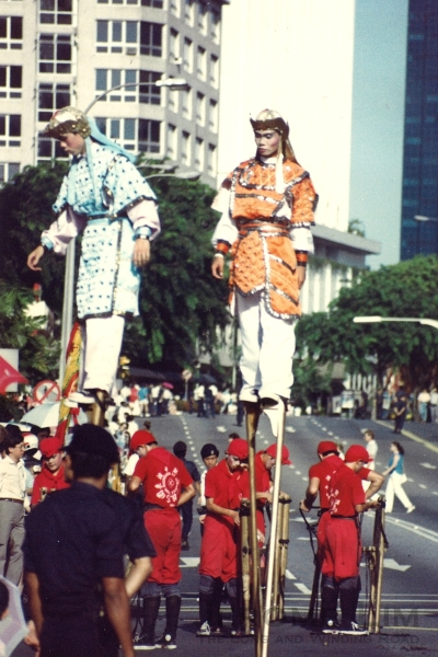 Stilt walkers from a Chinagy Parade in the 1980s seen along Orchard Road.