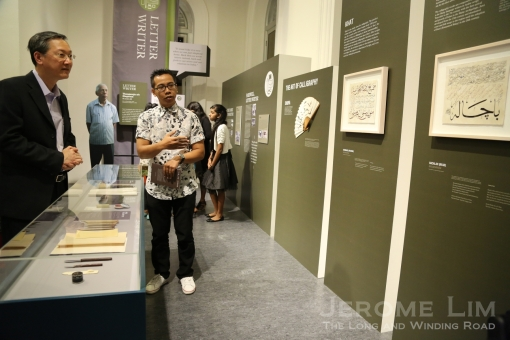 Mr Faizal Somadi, a khat calligrapher whose works are on display, speaking to Mr Sam Tan.