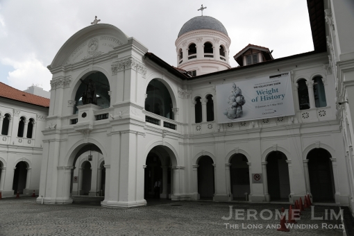 A building that was the school I went to - recoloured as a museum for contemporary art. The far corner to the right of the portico was where a fish pond shaded by a guava tree was in my schooldays.