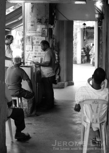 A mobile phone vendor along a five-foot-way at Serangoon Road.