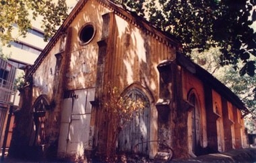 A photograph of the abandoned church building in the 1990s - after the motor workshop had vacated it (from Sculpture Square's website).