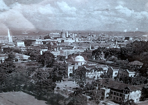 Detail of another postcard showing an aerial view of the city. The present National Museum can be seen in the foreground as well as the old YMCA Building.