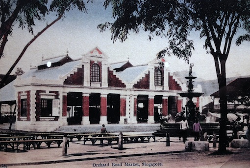 A photo of one of the postcards on display showing the former Orchard Road Market (where Orchard Point is today) in its early days before an extension at the front took away the little square and fountain. The fountain can now be found at Raffles Hotel.