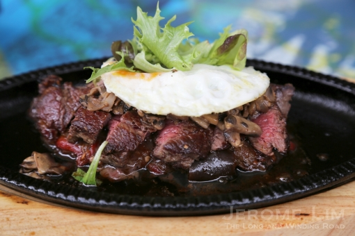 Grilled Ribeye (120g), Chachouka, Fried Egg And Grilled Mushrooms.