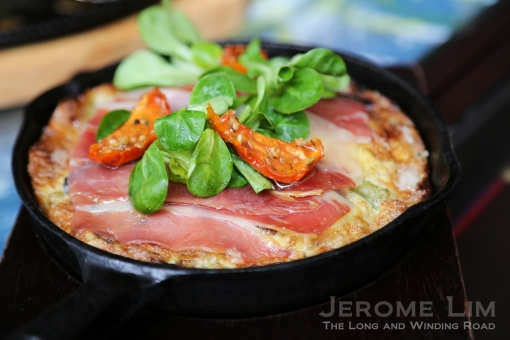 Fluffy Omelette, Roasted Potatoes , Manchego Cheese, Serrano Ham, Basil And Grilled Cherry Tomatoes.