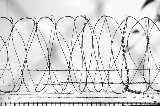 Concertina wire - a reminder of the former military site on the fence of the canteen.