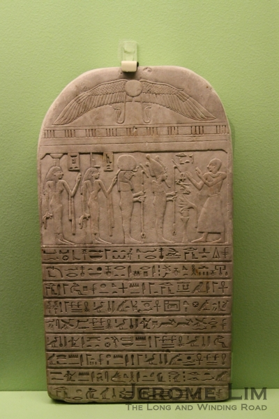 Round-topped funerary stela.