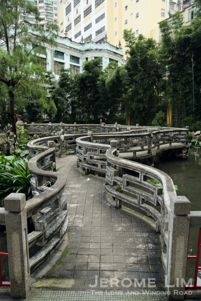 The nine-turn bridge with the former mansion, now part of Pui Ching Middle School, beyond it.