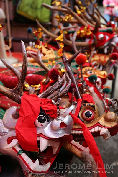Wooden head and tail sections of dragons lie in wait at the Kuan Tai Temple.