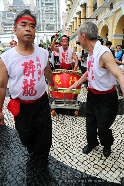 A drummer accompanies the participants.