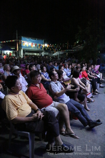 The large crowd seated in front of the stage.