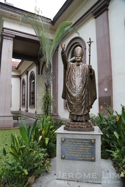 A statue of the late Pope John Paul II put up in 2006 to commemorate the 25th Anniversary of ties between the Vatican and Singapore and the 20th Anniversary of the Papal visit.
