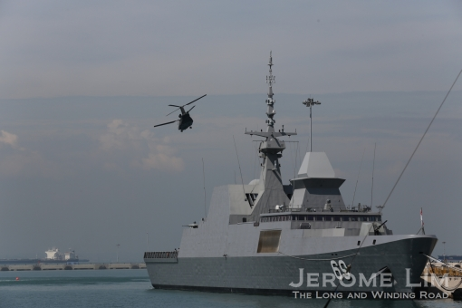 A Seahawk seen during the Dynamic Display - flying over one of the RSN's Frigates.