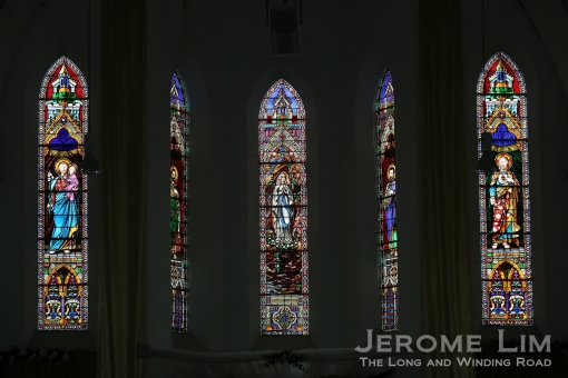 A close-up of the five panels of stained glass.