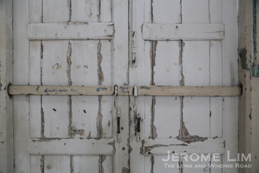 A wooden door at the transept entrance.