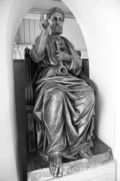The statue of St. Peter at the entrance.