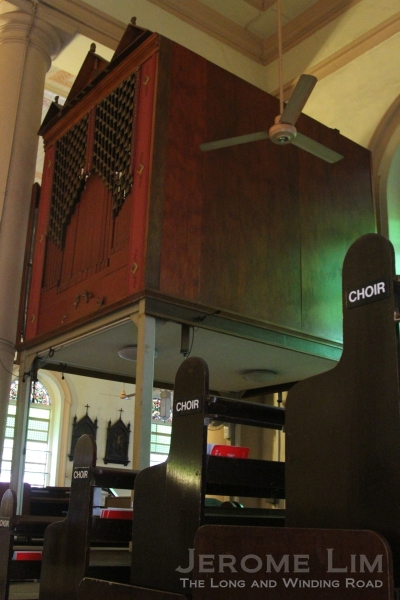 The more recently installed Choir Organ in the North Transept and the choir stalls.