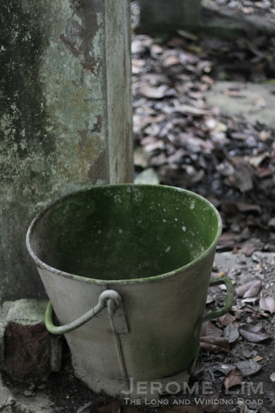 A metal pail close by.