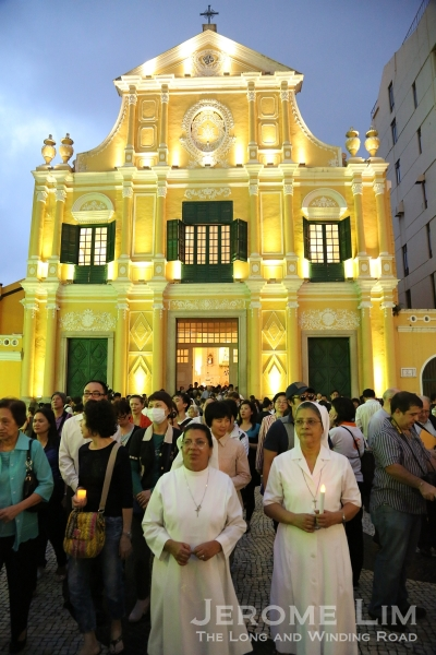 The congregation streaming out of St. Dominic's Church in Senado Square during the Feast of Our Lady of Fatima.