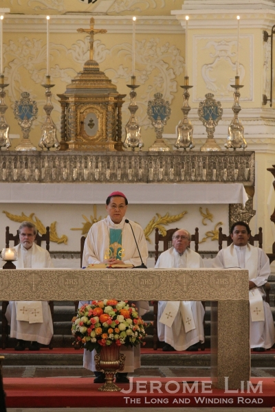 The Bishop of Macau, José Lai, celebrates mass at St. Dominic's Church before the procession.
