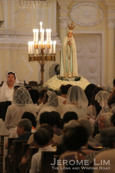 Our Lady of Fatima watches over the faithful in St. Dominic's Church during mass.
