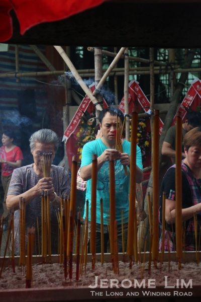 Devotees offering joss sticks at the Tam Kong Temple.