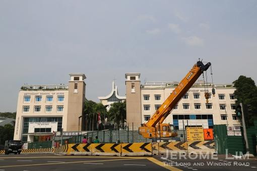 9 1/4 milestone Bukit Timah now dominated by new kids on the block as well as cranes and construction equipment.