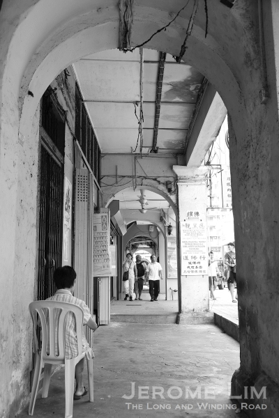 Watching time slowly pass on a five-foot-way along Jalan Sultan.