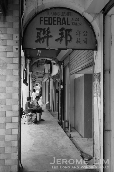 A five-foot-way along Jalan Petaling. A sign for a tailor shop which has closed reminds us of a time forgotten.