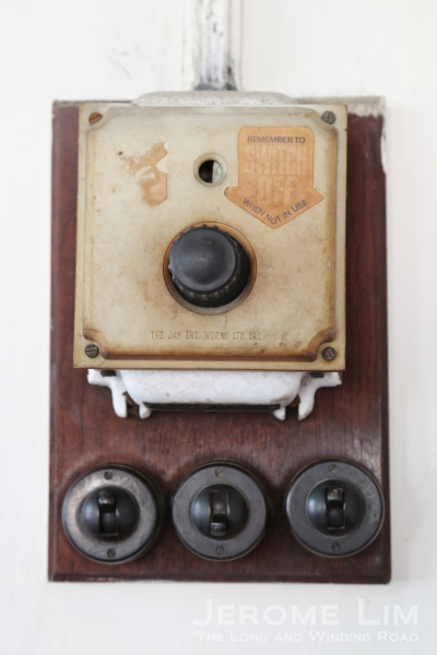 Bakelite switches and the controls of a ceiling fan.