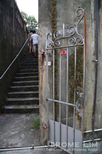 The stairway to the terrace on which the house is perched.