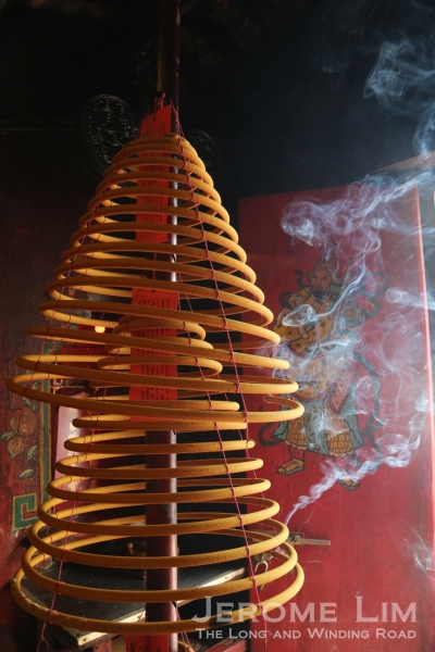 Smoke trails from incense coils at the Sma Seng Temple.