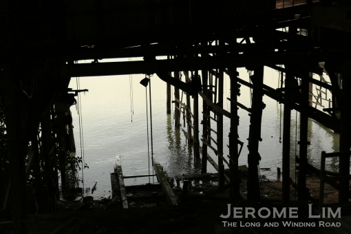 The sheltered slip of a abandoned boat yard. The village was a main centre for traditional wooden boat building in the Pearl River delta.