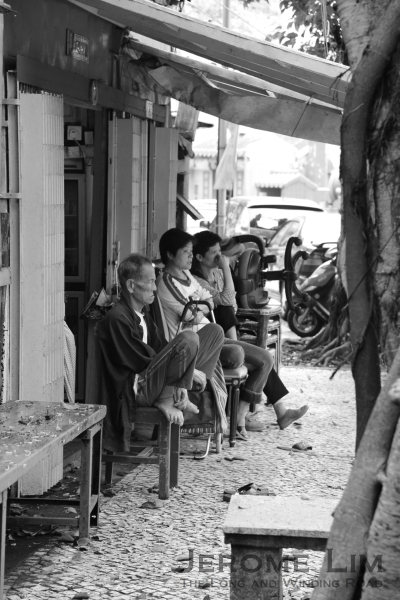 Villagers watching the world go by.