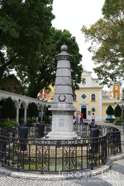 The Chapel of St. Francis Xavier at one end of  Eduardo Marques Square with a monument erected to commemorate the victory of the Portuguese over pirates in 1910.