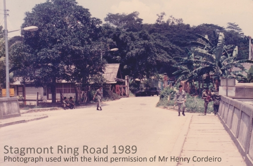 The road bridge over the Pang Sua Canal at Stagmont RIng Road with the crossing and gate hut seen beyond it  in 1989 (photograph used with the kind permission of Henry Corderio).