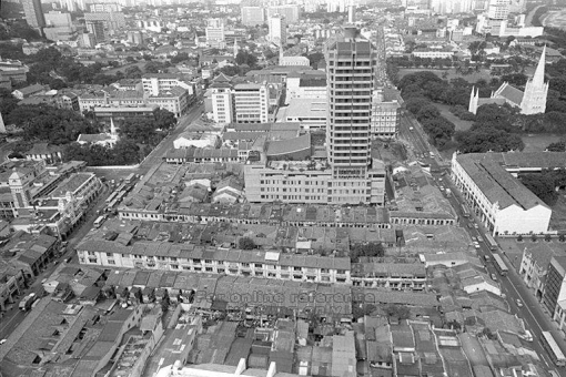The Hock Lam Street area (in the foreground) in 1976 from which businesses were moved temporarily to the Capitol Shopping Centre - the flat roofed building seen at the top of the picture (image source: http://a2o.nas.sg/picas/).