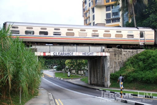 A train crossing the now missing girder bridge at Hillvew Road in early 2011.